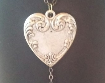 heart pendant with dangling moonstone