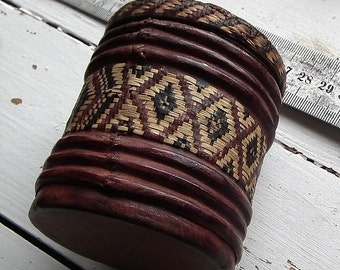 Ancient small   guineanan box, african  recycling art,  decorated with braided , painted leather+palmtree leaves . Typical African crafts