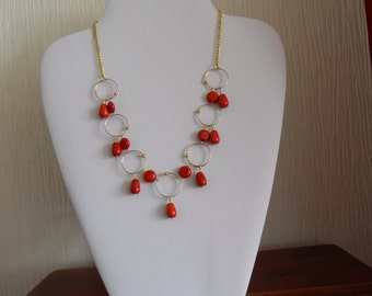 Red Magnesite Necklace with Drops and Coin Shaped Gems with Gold Hoop Features. Complete with Extender Chain.Compliments any Outfit