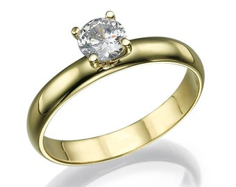 A 14 k gold ring white classic engagement ring