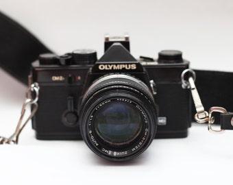 Olympus OM-2n 35mm SLR Manual Focus Camera (black) with Zuiko 50mm f/1.8 Lens