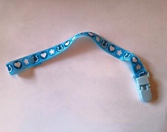 Blue pacifier clip
