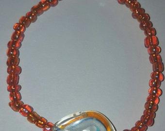 Handmade beaded elastic bracelet.