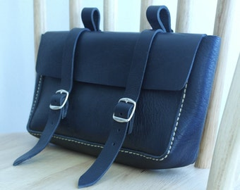 Saddlebag for hand-sewn black leather bike