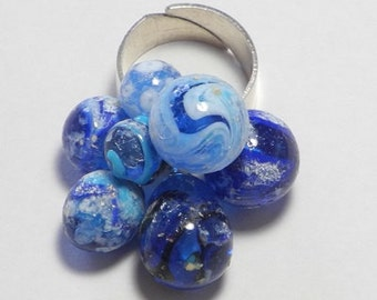 ring mobile and sound, cluster 7 glass beads spun on a wide Adjustable ring, shades of blue, porous and satiny surface