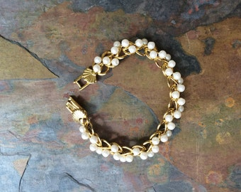 Gold tone and faux pearl bracelet