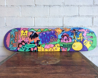 Original graffiti esque, funky, funny painting on old skateboard