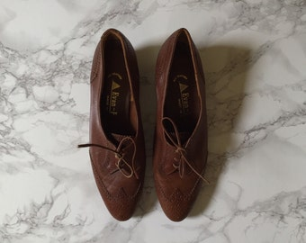 1970s chestnut brown oxfords / spectator perforated leather oxfords