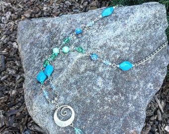 Blue/teal swirl