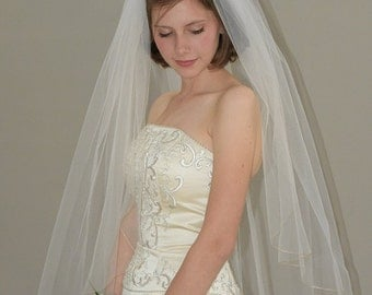 "42"" fingertip veil with silver trim pencil edging"