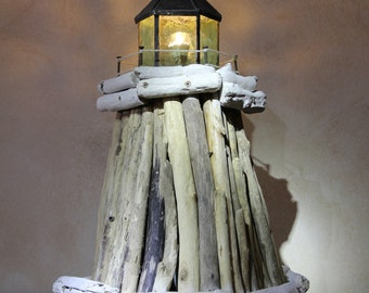 The lighthouse-beached wooden and glass lamp