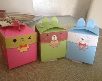 Bunny shaped box in the colors pink, green, blue