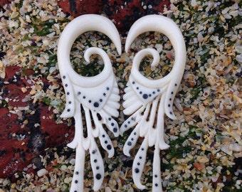 Hand-carved Bone Stretcher.