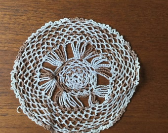 Brown and white crochet coaster