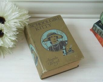 Schoolgirl Kitty by Angela Brazil. Hardback cloth bound book.