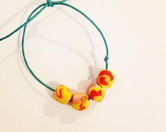 Orange marble clay bead bracelet