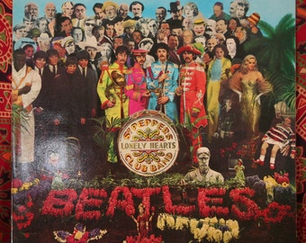 The Beatles - Sgt Pepper's Lonely Hearts Club Band - UK Pressing with original cut out insert.