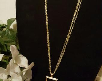 Silver single strand necklace w/ rectangle  pendant
