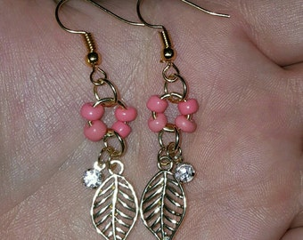 Hypoallergenic, yellow gold plated, coral accented leaf drop earrings
