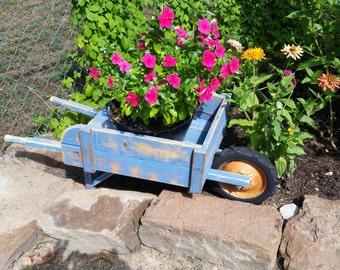 Small wheel barrow planters