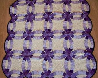 Handmade purple and cream double wedding ring quilt