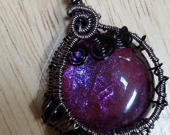 Wire wrapped purple pendant with black beads