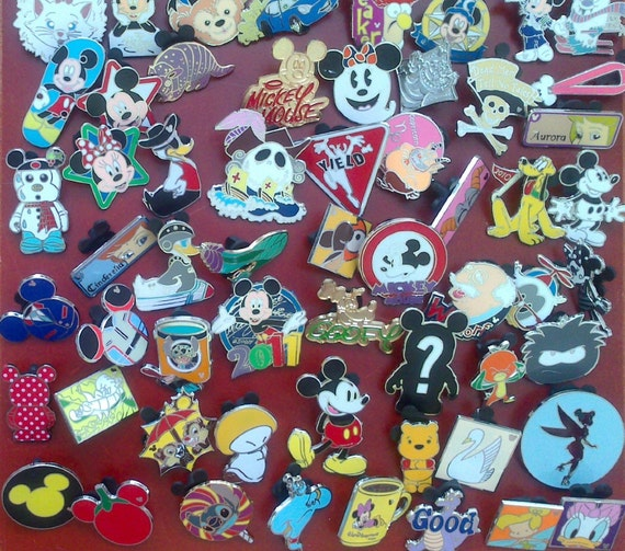 100 DISNEY TRADING PINS Great for scrapbook and pin trading at Disney World