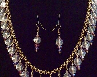 "A ""pools of light"" necklace and earring set"