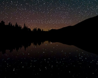 Stars Reflect in a Lake in the Rocky Mountains of Colorado