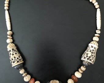 Carved necklace