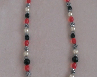 Black, red & pearl