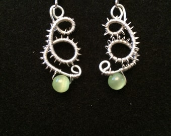 Steel wire wrapped light green glass beads