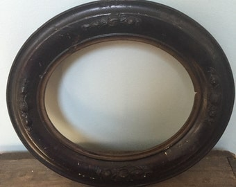 Vintage/antique oval empty wood frame.  Black and gold gesso plaster over wood.