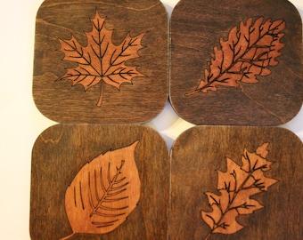 Set of four wood, leaf coasters