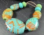 Summer encased lampwork pebble bead set