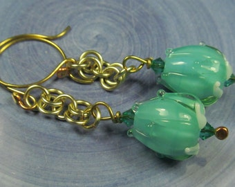 Pale opal green flower bud dangle earrings