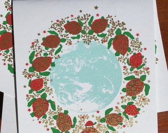 Sea Turtles swimming around the Earth decorate a Christmas card