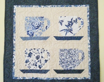 Tea Cup quilted wall hanging with dark blue border