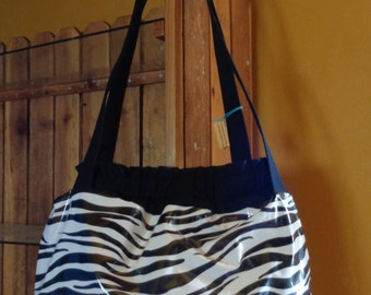 Large oil cloth zebra print bag clear out