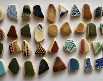 35  pieces of smooth beach pottery BPL18