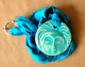 Handmade Ceramic Pendant with an Aqua Meditation Face - Sari Yarn Ribbon - Yoga jewelry - perfect for wedding or Blessingway
