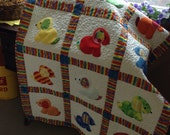 Puppy Love crib quilt for baby in rainbow colors