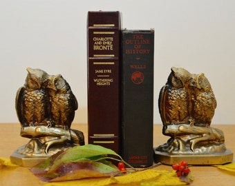 Pair of vintage cast brass owl bookends. Owls on branches by Philadelphia Manufacturing Company