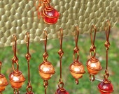 Recycled Brass & Aluminum Windchime with Copper Wrapped Ruby Red and Iridescent Orange Cat's Eye Glass Marbles