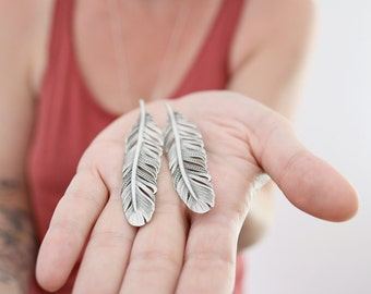 Feather earrings. Sterling silver feather earrings. Silver feather, feather dangles, bohemian soul, boho earrings, statement earrings.