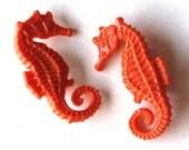 Orange pair of seahorse vintage plastic the life aquatic pin brooch