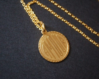 Gold tone amour necklace
