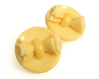 "Pretty Pair of Cream Colored Celluloid Buttons / Unique Buttons with Bow / 1-1/8"" Buttons"