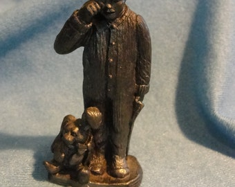 Vintage collectible pewter child figurine by Michael Ricker dater 1990 and numbered 4615