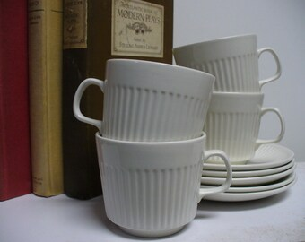 4 Johnson Brothers White Cups and Saucers